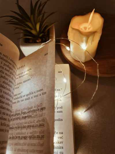 a book of poetry on a wooden table